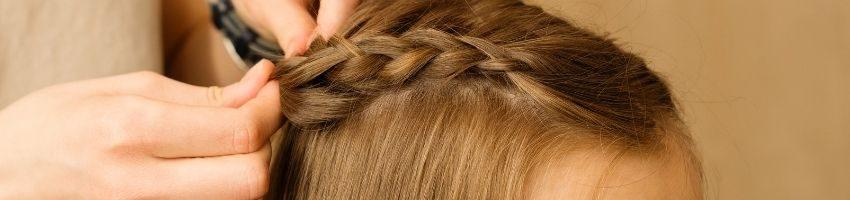 A close up of a braid in a girls hair.