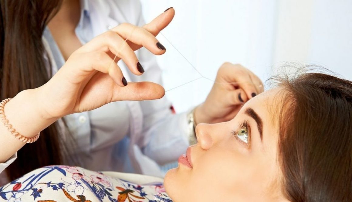 A young girl avail eyebrow threading in salon