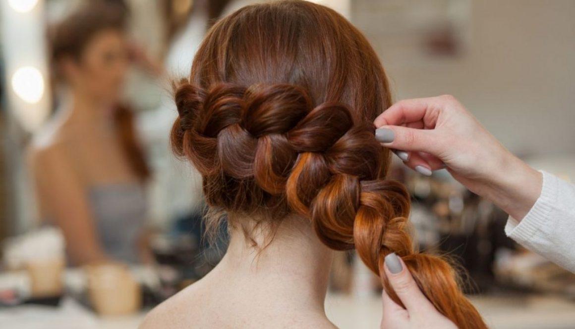 A woman getting her hair braided