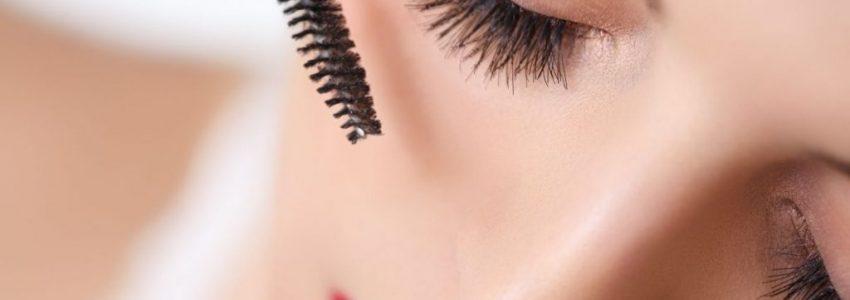 Teen girl carefuly brush her mascara