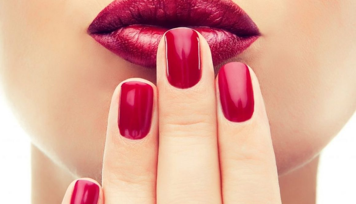 Young woman half faced angle show off her beautiful nails