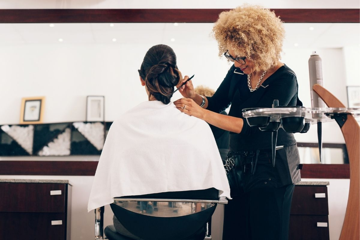 Celebrity Hair Stylists have ongoing styling to her client at the salon
