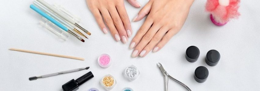 Young woman placed her nail tools under the white table